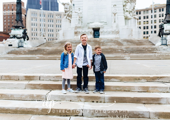 Children standing on steps in front of Soldiers and Sailors Monument in Indianapolis IN