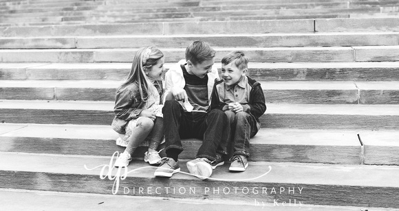 Children sitting on steps in front of Soldiers and Sailors Monument in Indianapolis IN