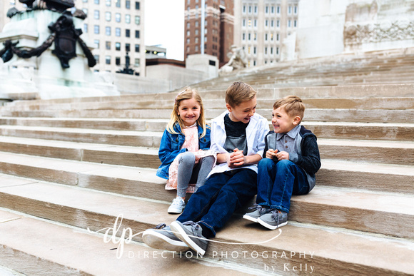 Attractive young family sitting on steps in Indianapolis IN