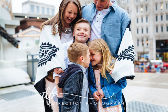 Attractive young family standing on steps in front of Soldiers and Sailors Monument in Indianapolis IN