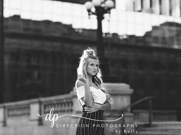 Attractive young woman posing for senior portraits in downtown Indianapolis IN