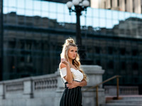 An attractive young woman posing for a senior portrait session in downtown Indianapolis IN