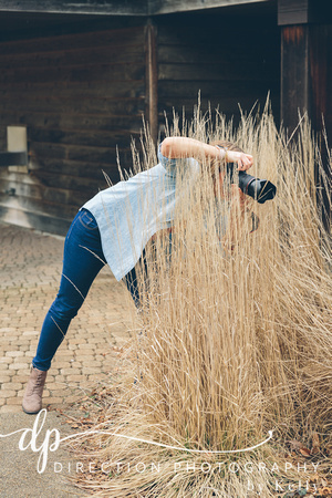 Kelly Hubert standing in tall prairie grass during a photography session