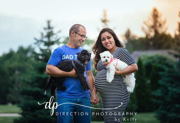 Husband and pregnant wife posing with their two dogs at Klehm Arboretum and Botanical Gardens in Rockford IL