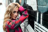 Close up portrait of a high school senior model leaning on a graffiti'd wall in downtown Chicago, Illinois